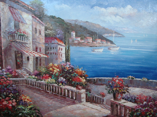Beautiful large painting, stretched but without frame, by Damini.  A stone path and stairs wind through a Mediterranean village surrounded by red, yellow and light blue flowers with sailboats floating in the dark blue sea in the background.