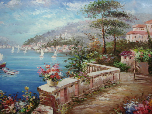 Beautiful, large painting, stretched but without frame, by Damini.  A short brick wall separates a blue sea with sailboats from flowering shrubs and villas in a coastal town.