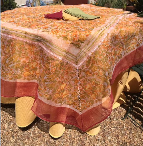 "Pair our organza with our round 110"" orange, red, yellow or green Provence tablecloth"