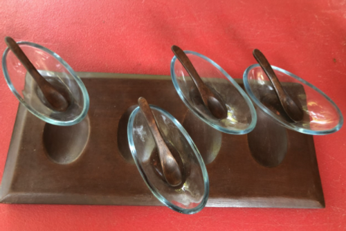 Set of 4 bowls on a board