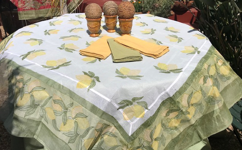 "Organza paired with our 110""green, yellow or white  Round Provence tablecloth"