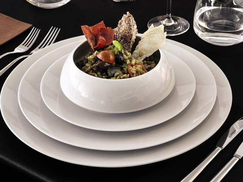 Rosenthal TAC 02 White service plate, dinner plate, salad plate and cream soup cup stacked on black surface