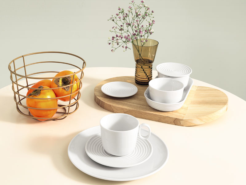 Thomas Ono dinnerware table setting on light green table cloth.