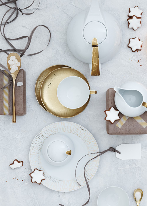 Rosenthal TAC skin gold festive table setting on a white table.