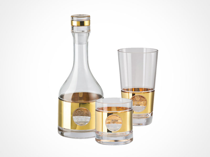 Versace Medusa Madness Oro bottle and glasses on white background.