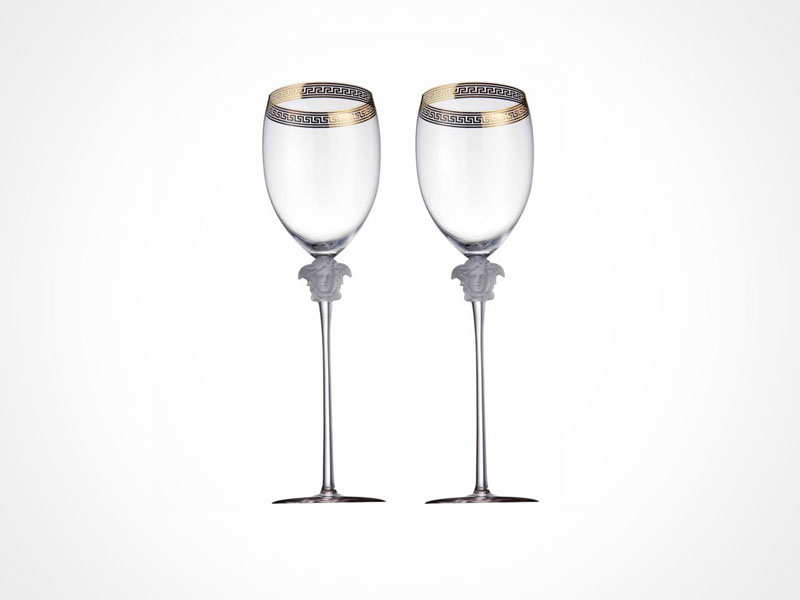 Versace Medusa D'Or wine glasses on white background.