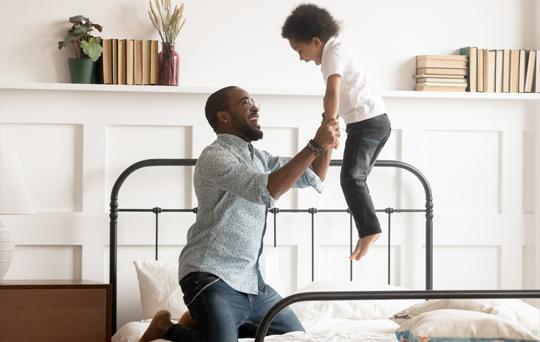 prod-sleep-dad-son-jump-bed.jpg
