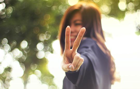 Woman Peace Gesture