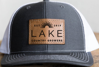 Support Locally grown with a Lake Country Growers  leather trucker hat
