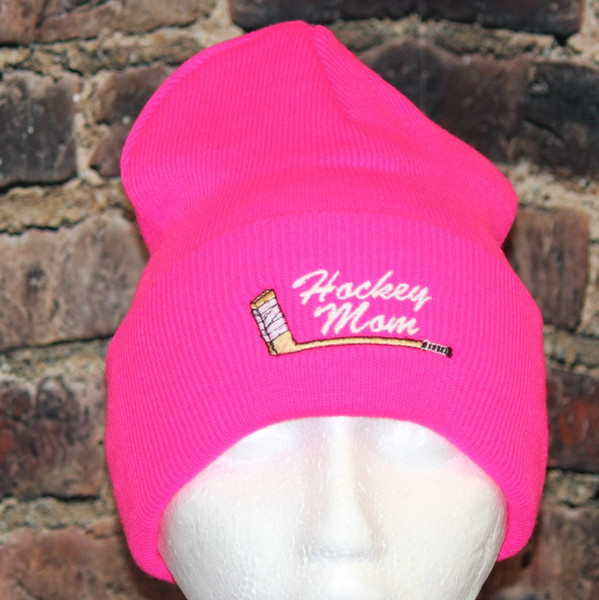 Hockey Mom with embroidered stick logo Hot pink cuff Toque
