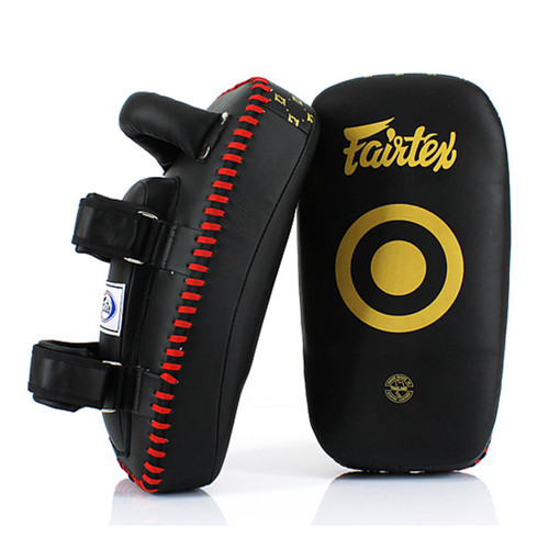 The Fairtex Lightweight Thai Kick Pads are easily maneuvered, allowing you to position them quickly and effectively. Two forearm straps help keep the pad firmly in place.   Made from Ocourless Microfibre material Ergonomically angled design provides a secure and comfortable fit Lightweight with soft pads Comes with padded straps and forearm support Extra Padding for Forearm Support