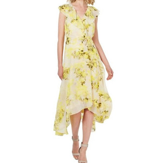 Calvin Klein's wrap dress flutters and flatters in a layer of soft chiffon brightened by a cheery floral print.