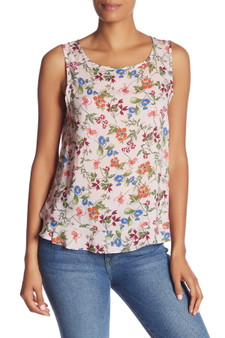 Springtime printed florals decorate a sleeveless top for a feminine, graceful ensemble.