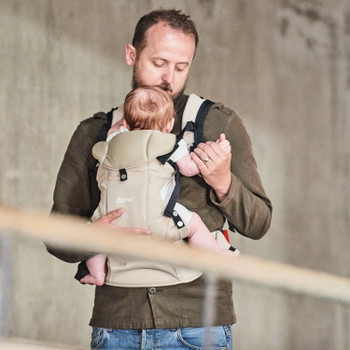 Baby and Father using the Diono Carus Complete 4-in-1 Child & Baby Carrying System with Detachable Backpack [Sand]
