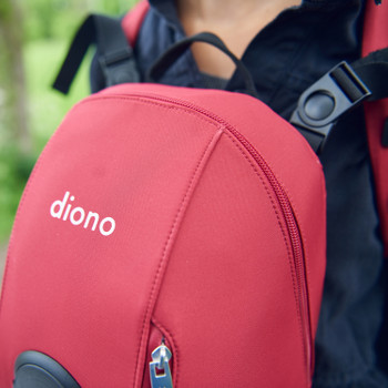 Close up of Child and Mother using the Diono Carus Complete 4-in-1 Child & Baby Carrying System with Detachable Backpack [Red]