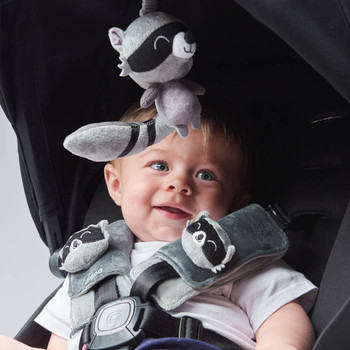 Soft wraps® harness pads and multi-sensory toy shown on stroller [Raccoon]