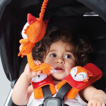 Soft wraps® harness pads and multi-sensory toy shown on stroller  [Fox]