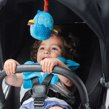 Soft wraps® harness pads and multi-sensory toy shown on stroller [Owl]