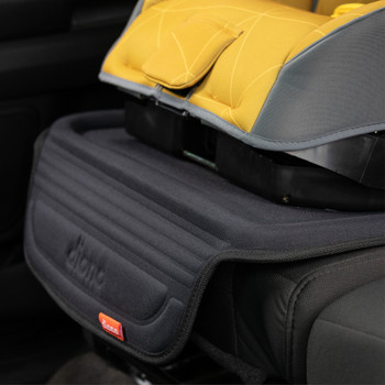 Diono Seat Guard Complete - Installed in the back seat of a car closeup  [Black]