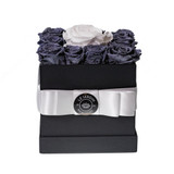 Ultimate indulgence in gift giving. Our square black hat box is filled with our beautiful, preserved roses. LJNY petite arrangement dimensions are 6inch X 6inch and contains 13 beautiful roses that last up-to a year. Our hat boxes collection has been designed and imagined to enhance the décor for any and every room. Petite arrangement of preserved roses is a small gesture with big impression.   Perfect for birthdays, anniversaries, holidays, or simply for capturing the moment! For further color requests or anything bespoke please contact our LJNY team. Available to include: chocolate Ferrero Collection; greeting card; rose scented essential oil/diffuser; rose scented candle.  Instructions: Please do not remove flowers from box, this will damage the flowers and arrangement. Flowers are natural and their sizes may vary.  No watering or maintenance is required so the recipient can continue to treasure the arrangement day after day. Handle with care. Do not expose to direct light or excessive heat. Roses will radiate beauty for up to a year. LJNY flowers are naturally preserved and may have a slight variation in shape and color and amount used in arrangement.