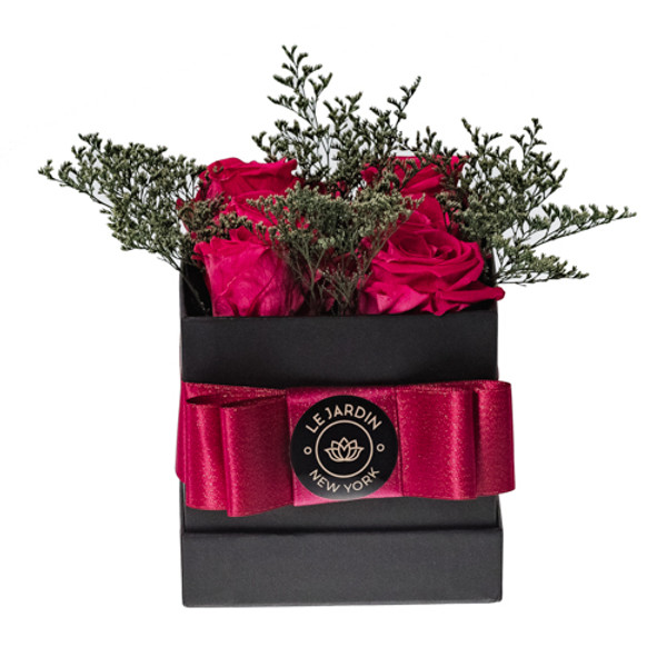 Ultimate indulgence in gift giving. Our square black hat box is filled with our beautiful, preserved roses. LJNY petite arrangement dimensions are 4.4inch X 4.4inch and contains 4 beautiful roses that last up-to a year. Our hat boxes collection has been designed and imagined to enhance the décor for any and every room. Petite arrangement of preserved roses is a small gesture with big impression.   Perfect for birthdays, anniversaries, holidays, or simply for capturing the moment! For further color requests or anything bespoke please contact our LJNY team. Available to include: chocolate Ferrero Collection; greeting card; rose scented essential oil/diffuser; rose scented candle.  Instructions: Please do not remove flowers from box, this will damage the flowers and arrangement. Flowers are natural and their sizes may vary.  No watering or maintenance is required so the recipient can continue to treasure the arrangement day after day. Handle with care. Do not expose to direct light or excessive heat. Roses will radiate beauty for up to a year. LJNY flowers are naturally preserved and may have a slight variation in shape and color and amount used in arrangement.