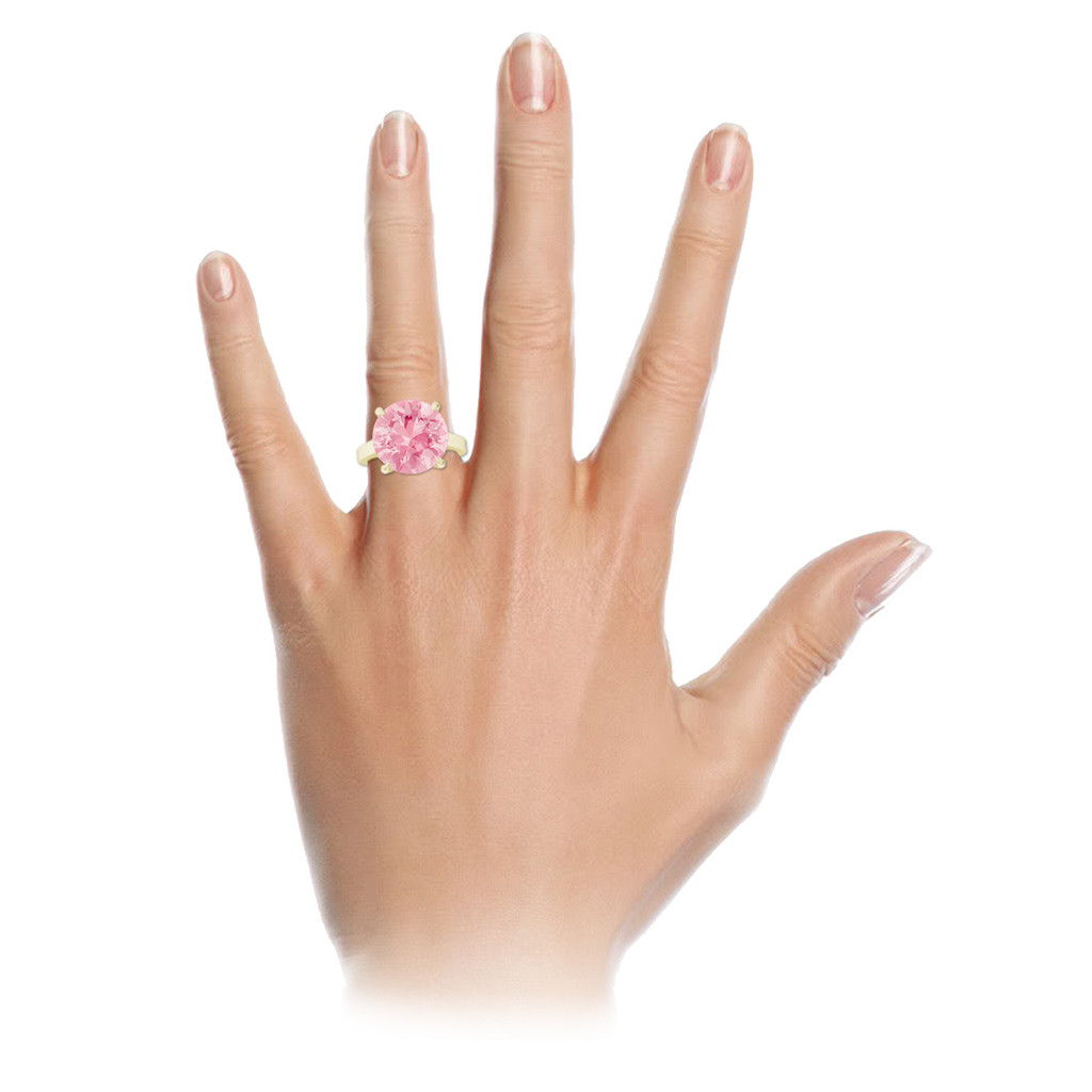 stylerocks-round-brilliant-cut-pink-sapphire-yellow-gold-ring-on-hand