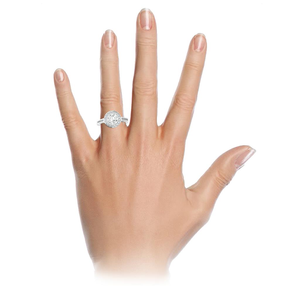 round-brilliant-cut-1carat-diamond-halo-diamond-band-18carat-white-gold-engagement-ring-stylerocks-on-hand