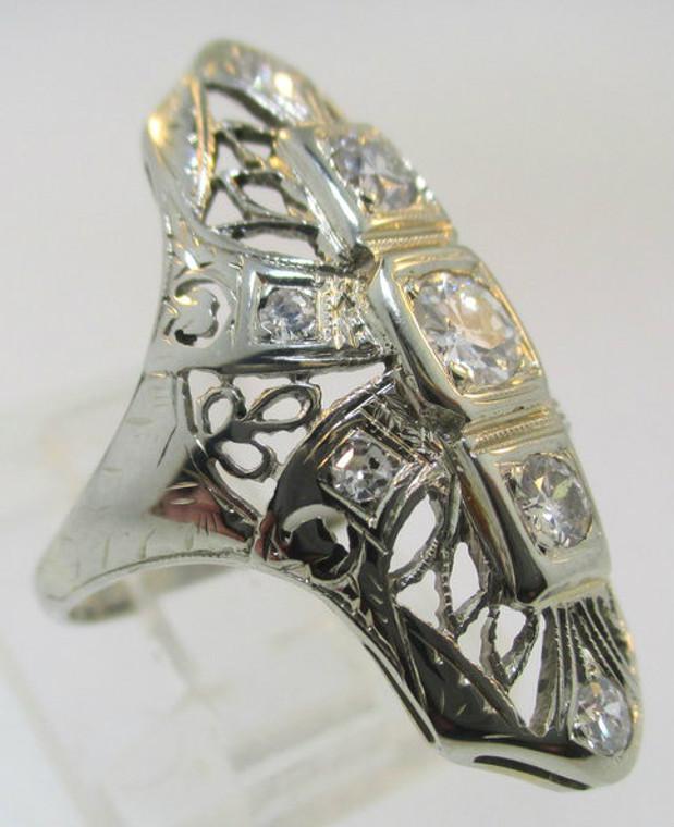 Vintage 1920's 18k White Gold, approximate .17ct diamond center stone with 2- approximate .02-.03ct diamonds.