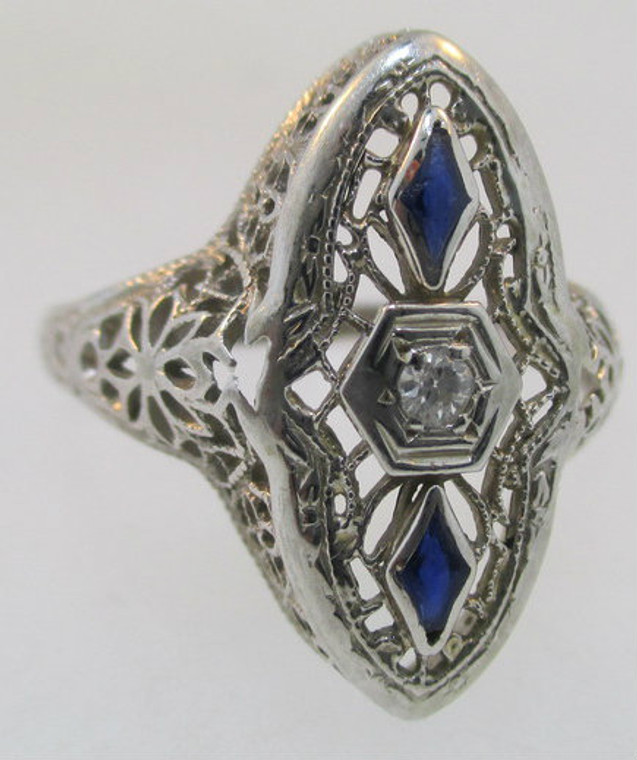 Vintage 1920's 14k White Gold Round Brilliant cut approx. .01-.02ct Diamond Ring. 2- Marquise Sapphires on each side of the diamond center stone. Filigree accenting around band. Size 6 ¾.*
