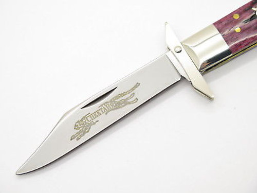 2002 CASE XX 6111 1/2 CHEETAH SCRIPT CRANBERRY SWING GUARD FOLDING KNIFE