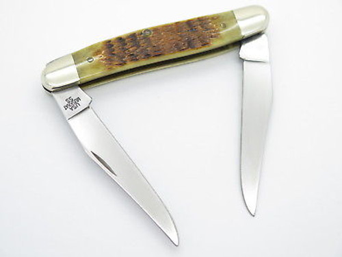 2000 CASE XX MUSKRAT FOLDING POCKET KNIFE JIGGED AMBER BONE