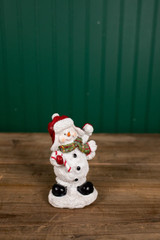 Small Resin Playful Candy Cane Snowman