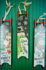 """27.5"""" Wood Holiday Snowman Sleigh with Metal Snowflakes"""