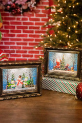 """9.5"""" Battery Operated Lighted Spinning Water Globe Frame with Holiday Scene and Timer"""
