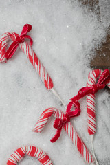 """26"""" Frost Peppermint Candy Cane with Bow Spray"""