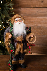 "18"" Standing Santa Grey Coat W/ Garland/Stick/Bells"