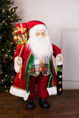 "24"" Standing Santa Red W/ Plaid Vest/Jingle Bells/Presents"