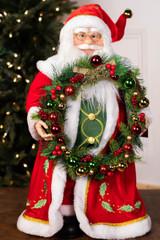 "24"" Standing Santa Red Coat W/ Wreath"