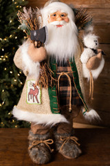 """32"""" Standing Santa Wooly Coat W/ Axe/Teddy Bear"""
