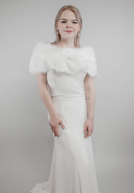 The must have accessory for any Winter bride. Stay warm while adding a touch of classic elegance to your wedding photos. Perfect for the bride or the entire entourage.