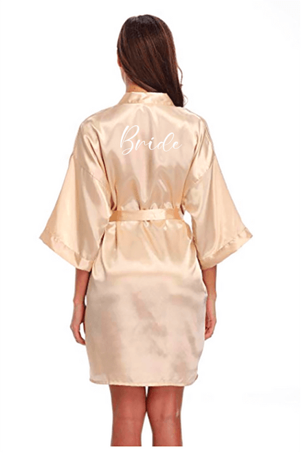 Champagne robe with white lettering