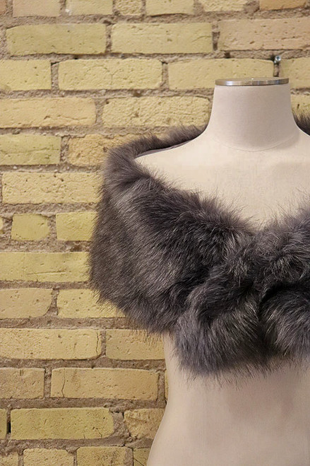 Wrap yourself in luxury. Stay warm and look oh so fancy in this vegan fur wrap.
