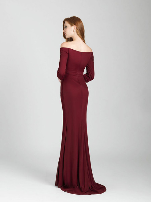 Subtle ruching creates the illusion of a wrap dress, featuring a high slit at one leg.