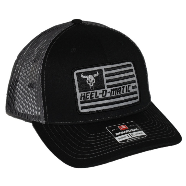 Black with Charcoal mesh. Heel-O-Matic flag patch on front.  Richardson 112 adjustable snapback.