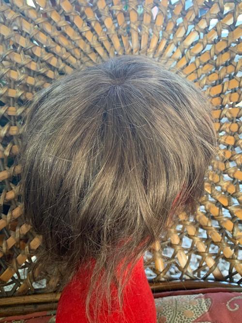 Silky straight human hair topper.