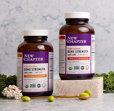 Plant Calcium supplement for bone strength, surrounded by herbal ingredients with a mortar and pestle