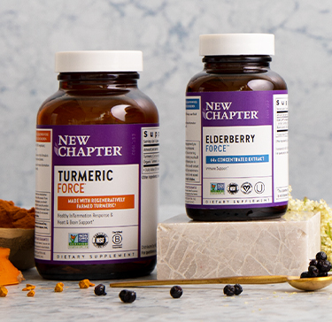 Turmeric, elderberry, and 10-herb inflammation supplements displayed with a mortar and pestle