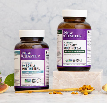 New Chapter daily multiherbal supplements surrounded by herbal ingredients