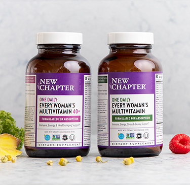 Assortment of whole-food multivitamins, surrounded by herbal ingredients