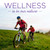 Two bikers on a hillside, taglined Wellness is in Our Nature.